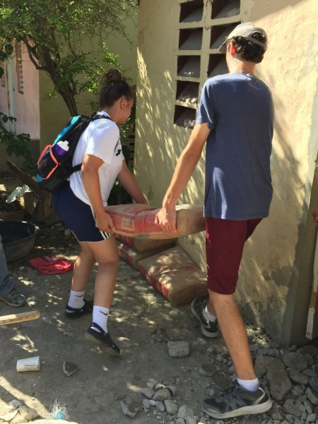 Carrying cement from the church