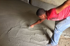 Luisito, a Maestro (construction leader), finishing a floor